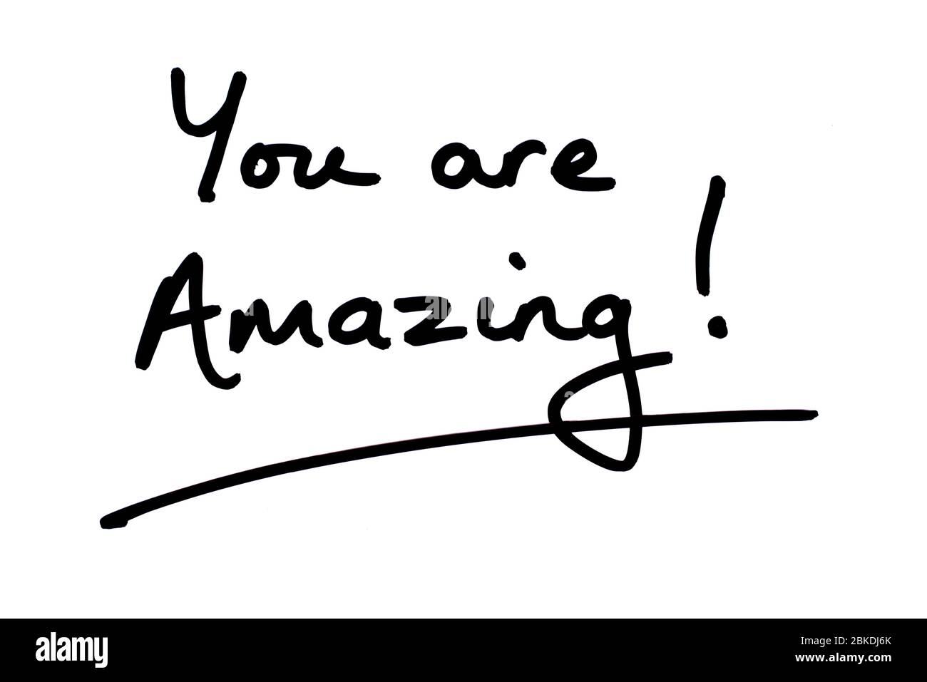 You are Amazing! handwritten on a white background. Stock Photo