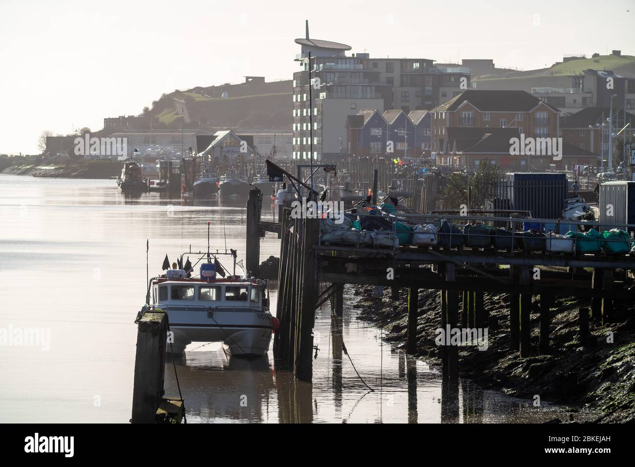Boats along Newhaven West Quay, East Sussex. UK Stock Photo