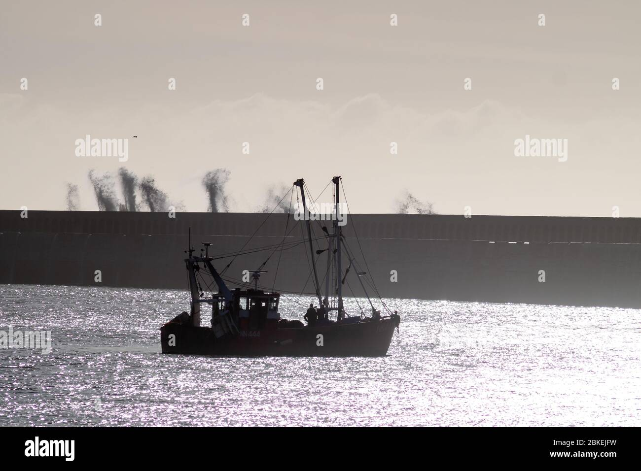 Small fishing boat in Newhaven Harbour Stock Photo