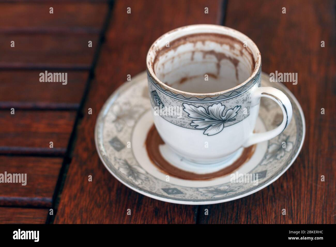 Finished Cup of Turkish Coffee on wooden background waiting for fortune telling Stock Photo