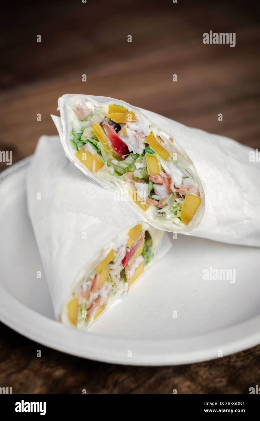 crab mayonnaise and salad wrap on wooden table background Stock Photo