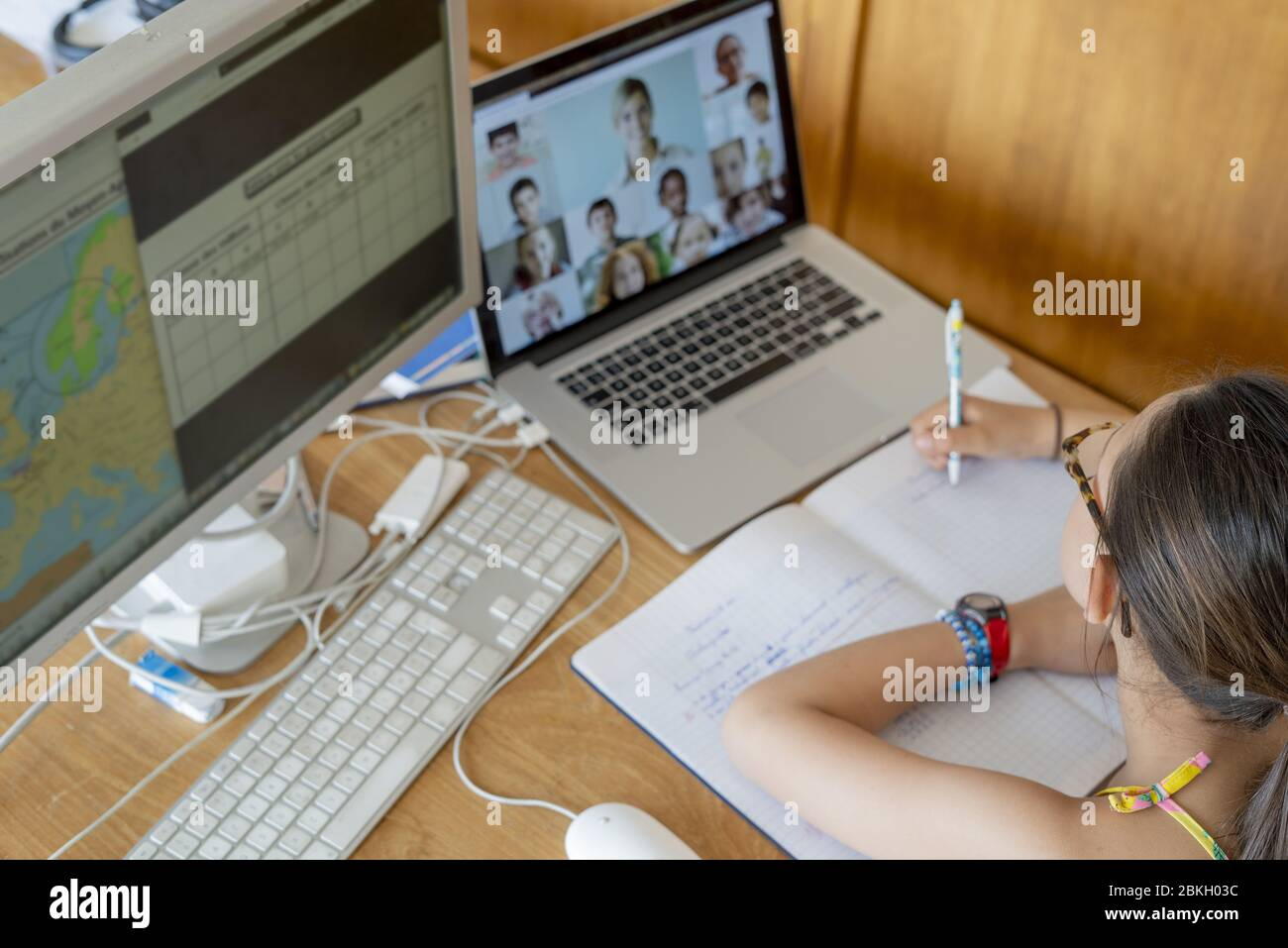 Girl attending online school classes from home Stock Photo