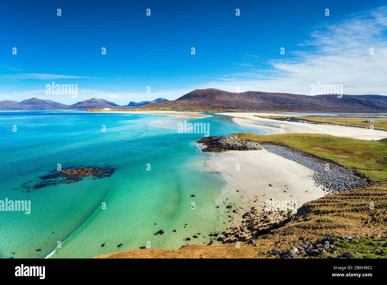 The beautiful sandy beach and clear turquoise sea at Seilebost on the isle of Harris in the Western isles of Scotland Stock Photo