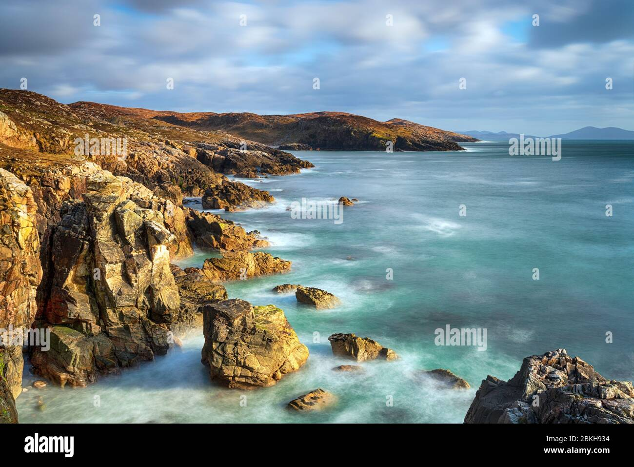 A long exposure of the rocky cliffs at Hushinish on the isle of Harris coast in the Outer Hebrides of Scotland Stock Photo