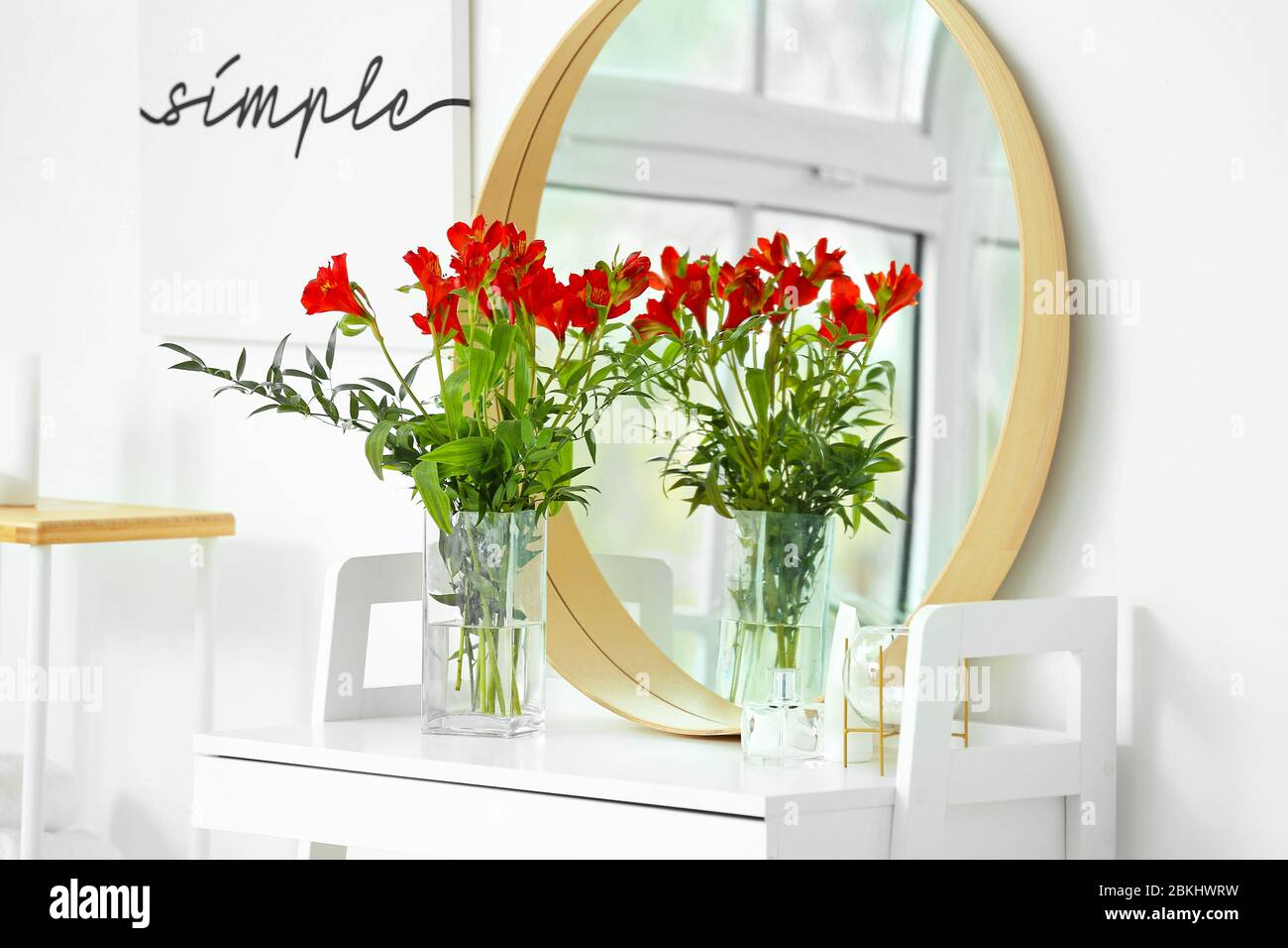 Stylish vase with floral decor in interior of bathroom Stock Photo