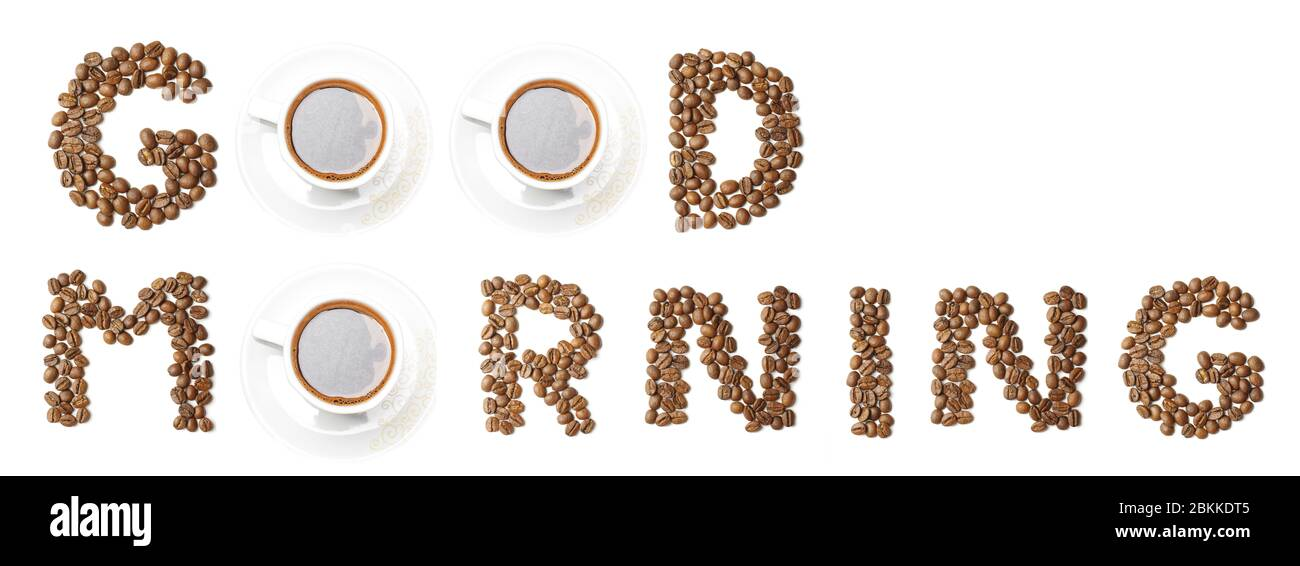 Words GOOD MORNING arranged from coffee beans and mugs in creative way Stock Photo