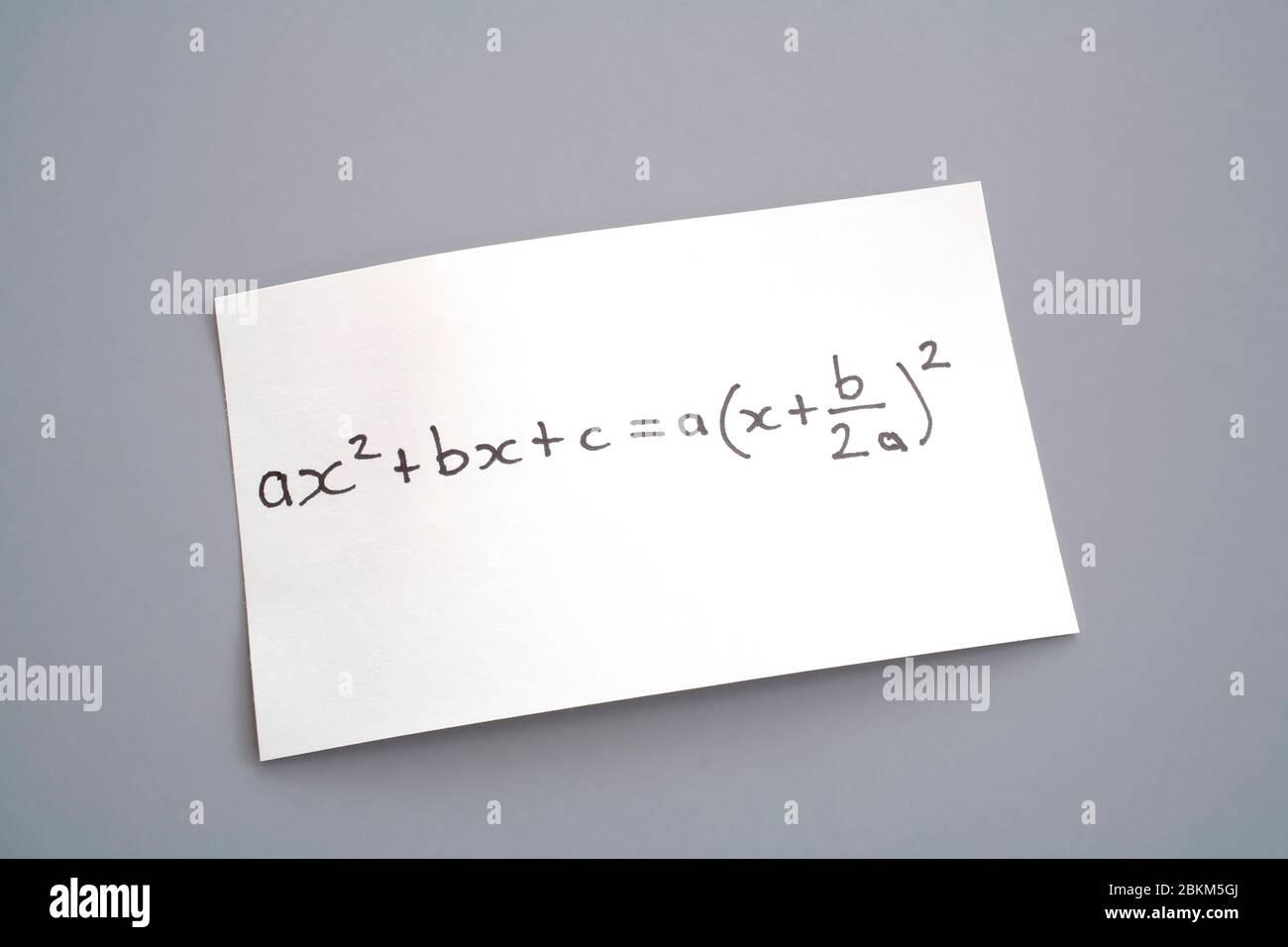 algebra equation on piece of paper Stock Photo