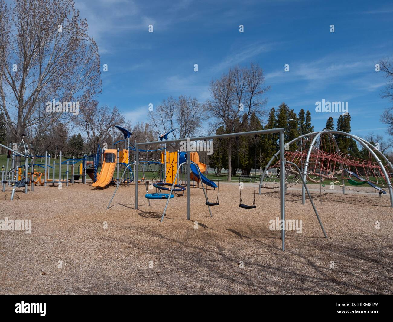 A Large Abandoned Playground With Orange And Blue Slides Swings And Rope Bridges Photographed During The Pandemic Stock Photo Alamy