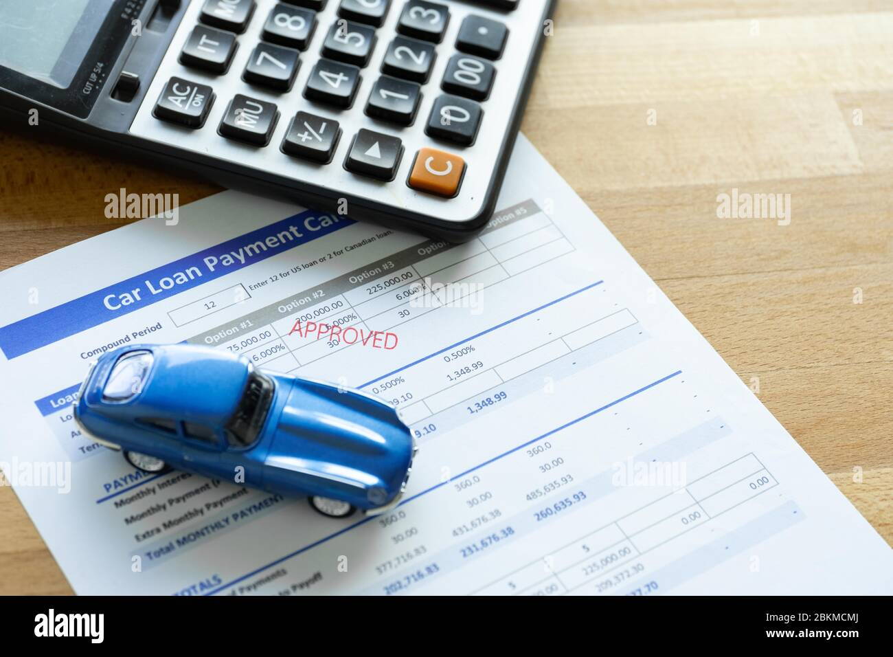 Car Loan Agreement Approved By Financial Bank Payment Contract Calculator Form A Blue Car With Paper On The Table With Copy Space Stock Photo Alamy
