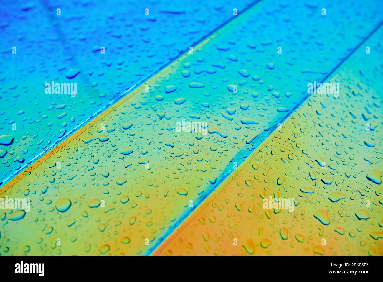 Chameleon Holographic Surface With Water Drops After The Rain Car Wrapping Background Rainbow Colour Paint Stock Photo Alamy