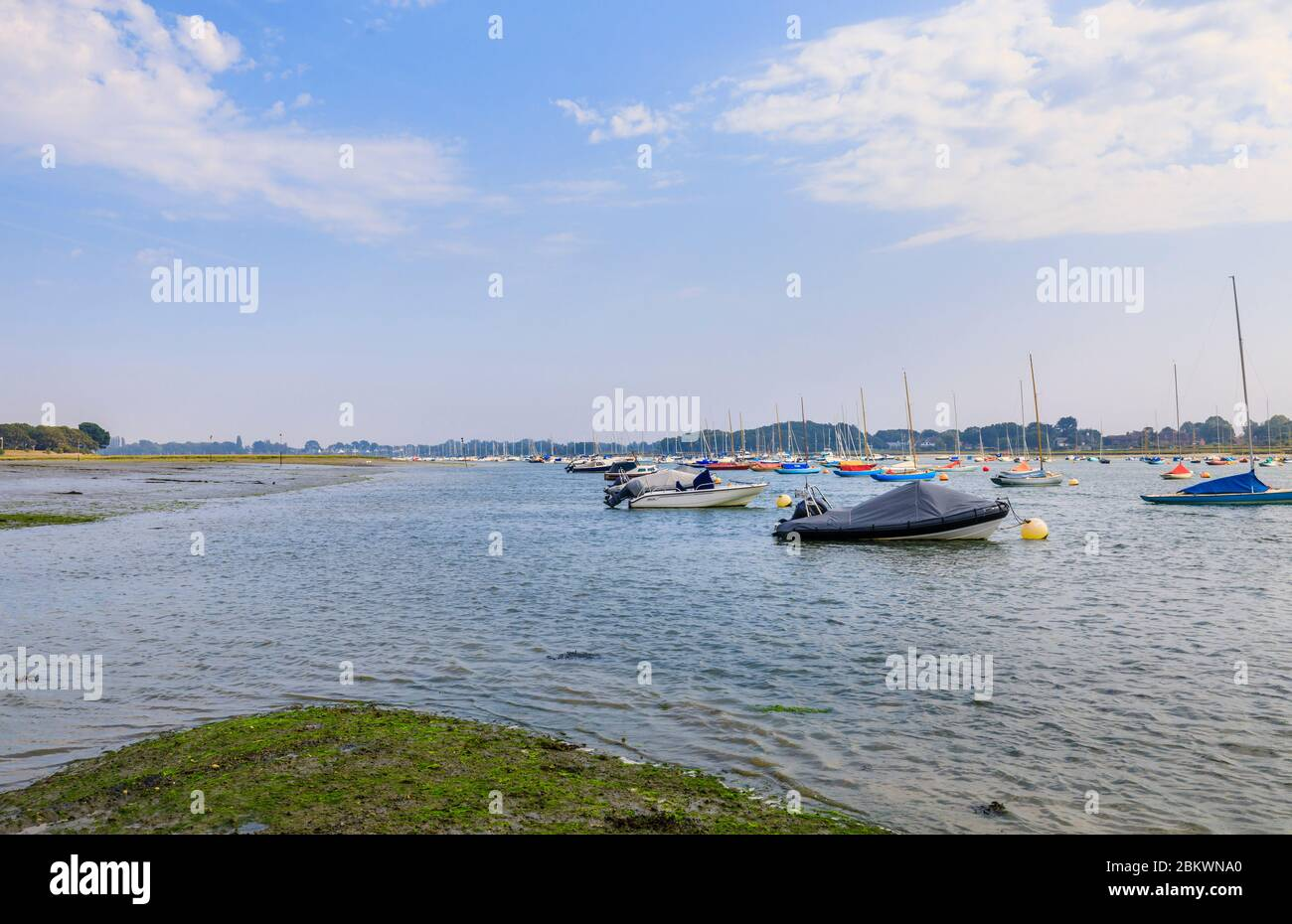 Sailing boats moored by the Smugglers Lane and Ferry Hard intertidal saltmarsh areas at low tide, Bosham, Chichester Harbour, south coast England Stock Photo