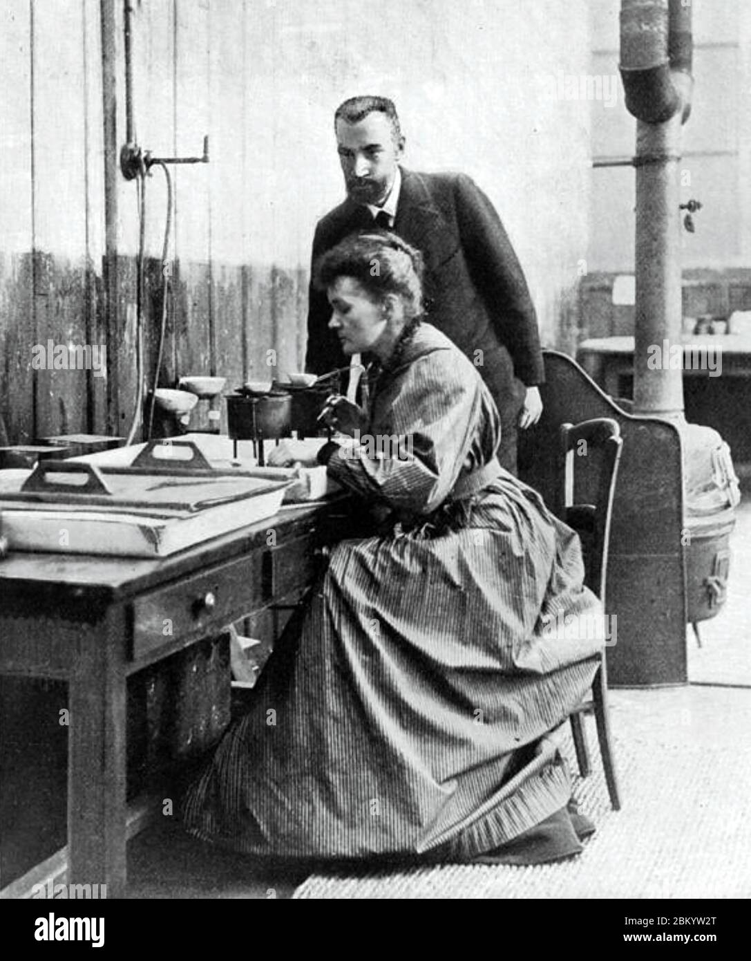 MARIE AND PIERRE CURIE at work in their Paris laboratory about 1905 Stock Photo