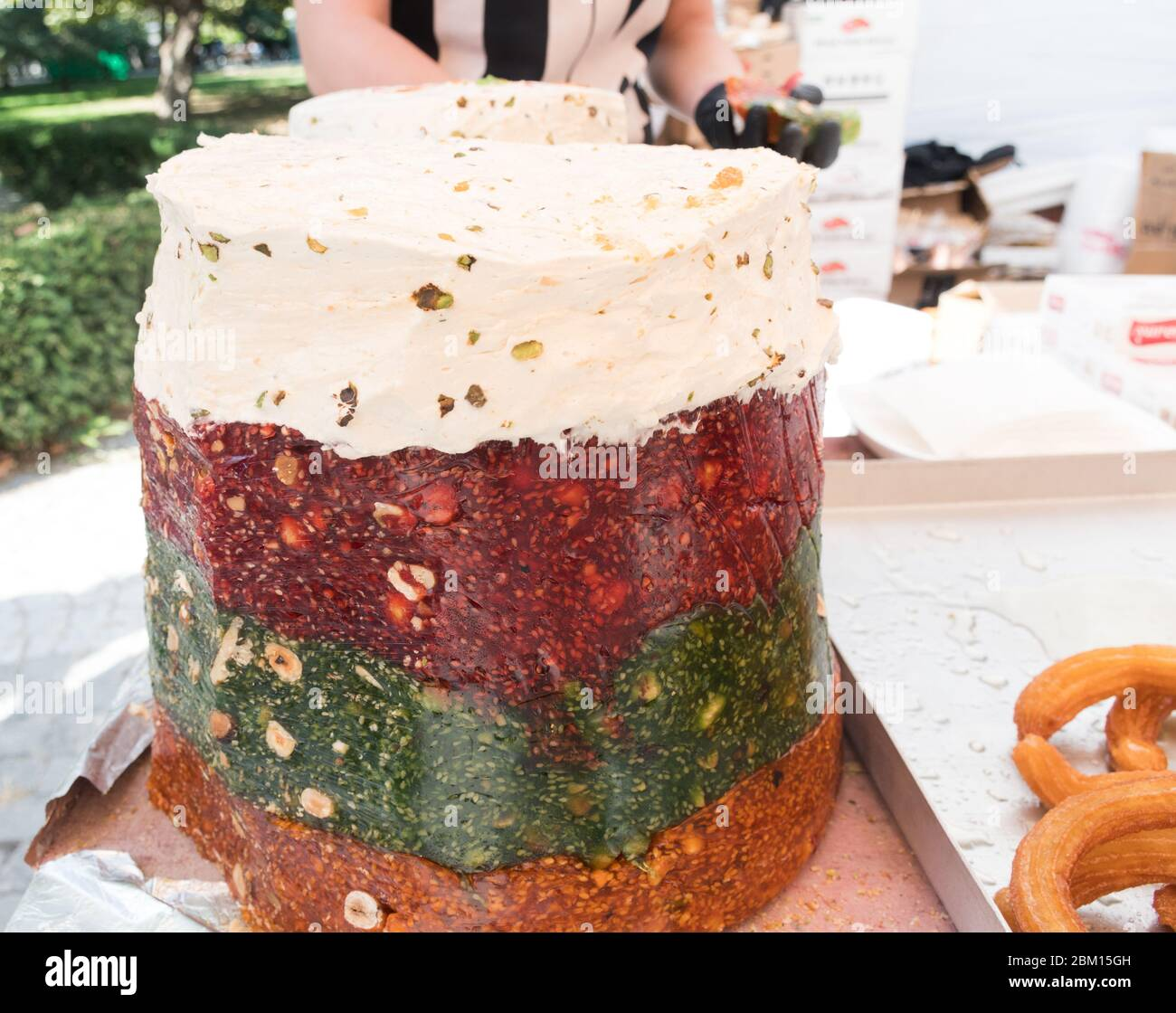 Cezerye, a semi-gelatinous traditional Turkish dessert made from caramelised carrots, shredded coconut, and roasted walnuts, hazelnuts, or pistachios. Stock Photo