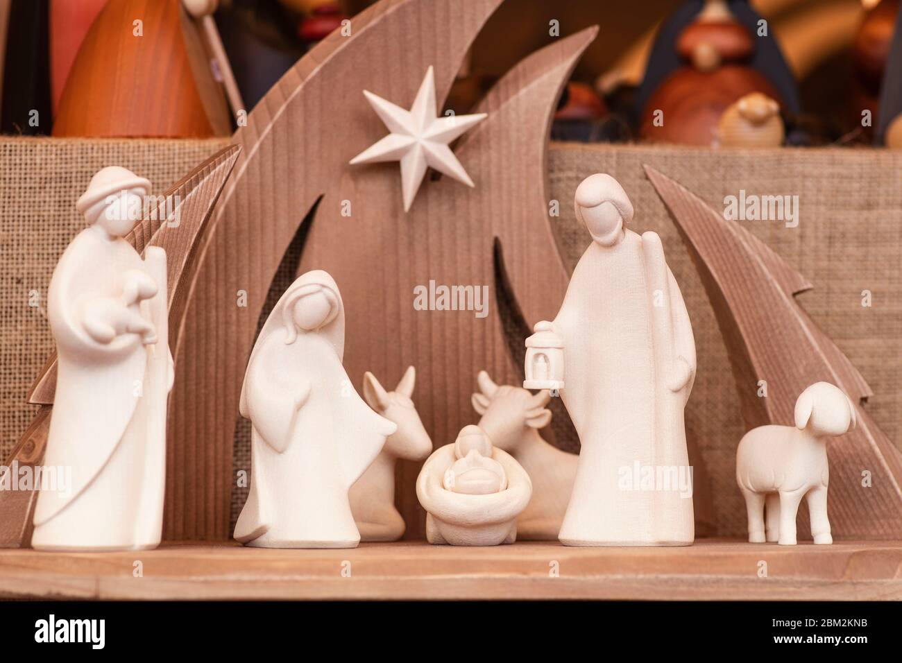 Christmas wooden figurines.Christmas nativity scene wooden figurines inside a wooden house representing the holy family. Stock Photo