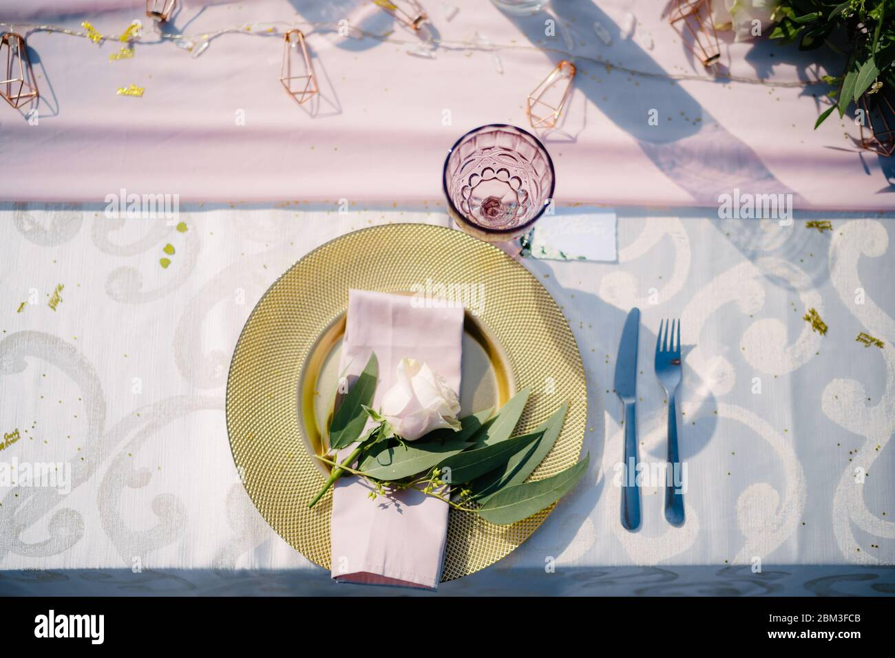 Wedding Dinner Table Reception Gold Plate With Pink Cloth Napkin And Olive Leaves Raspberry Old Glass Glass A Floral Arrangement In The Center Of Stock Photo Alamy