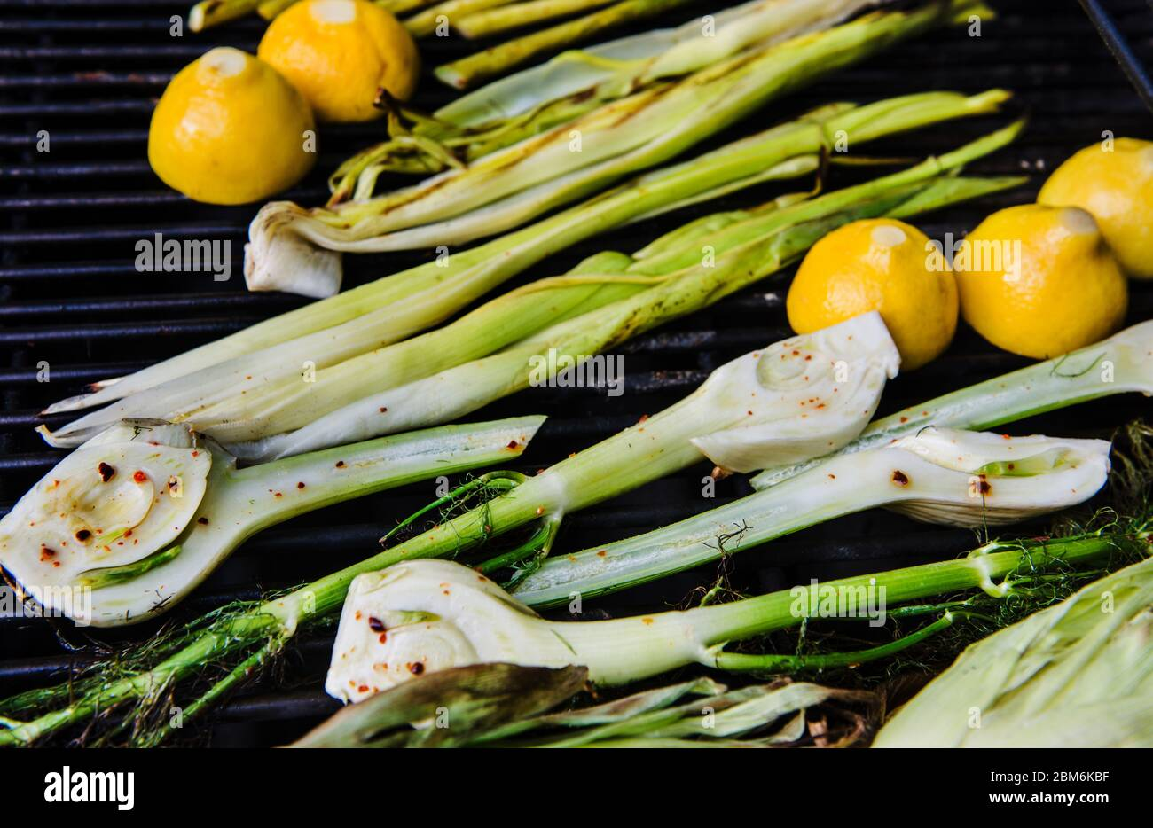 Fresh grilled summer produce of fennel and lemon Stock Photo