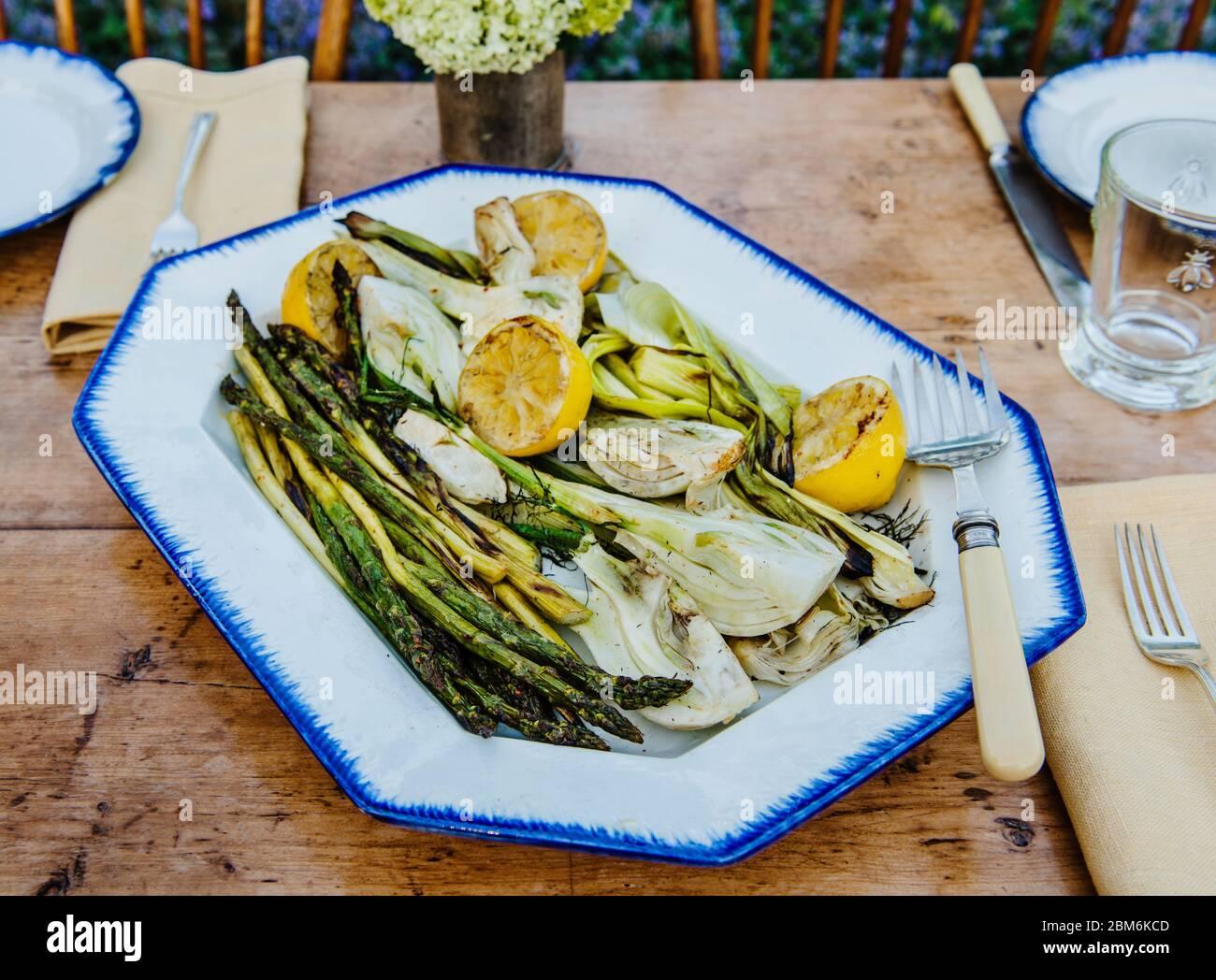 Grilled Summer vegetables of asparagus, fennel and lemon Stock Photo