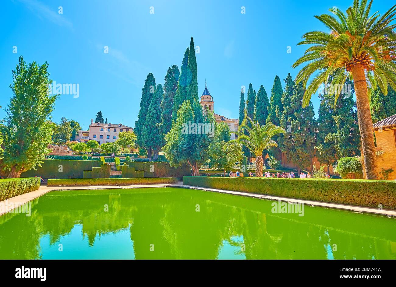 Granada Spain September 25 2019 The Pool Surrounded By Scenic Topiary Partal Garden Flower Beds And Tall Thuja Trees Alhambra On September 25 Stock Photo Alamy