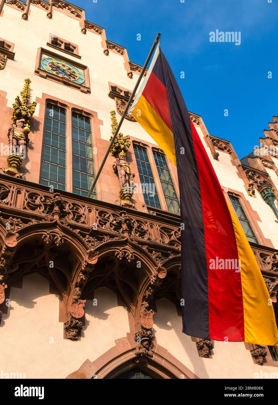 German flag outside the reconstructed Romer building, the ancient town hall of Frankfurt am Main, Hesse, Germany. Stock Photo