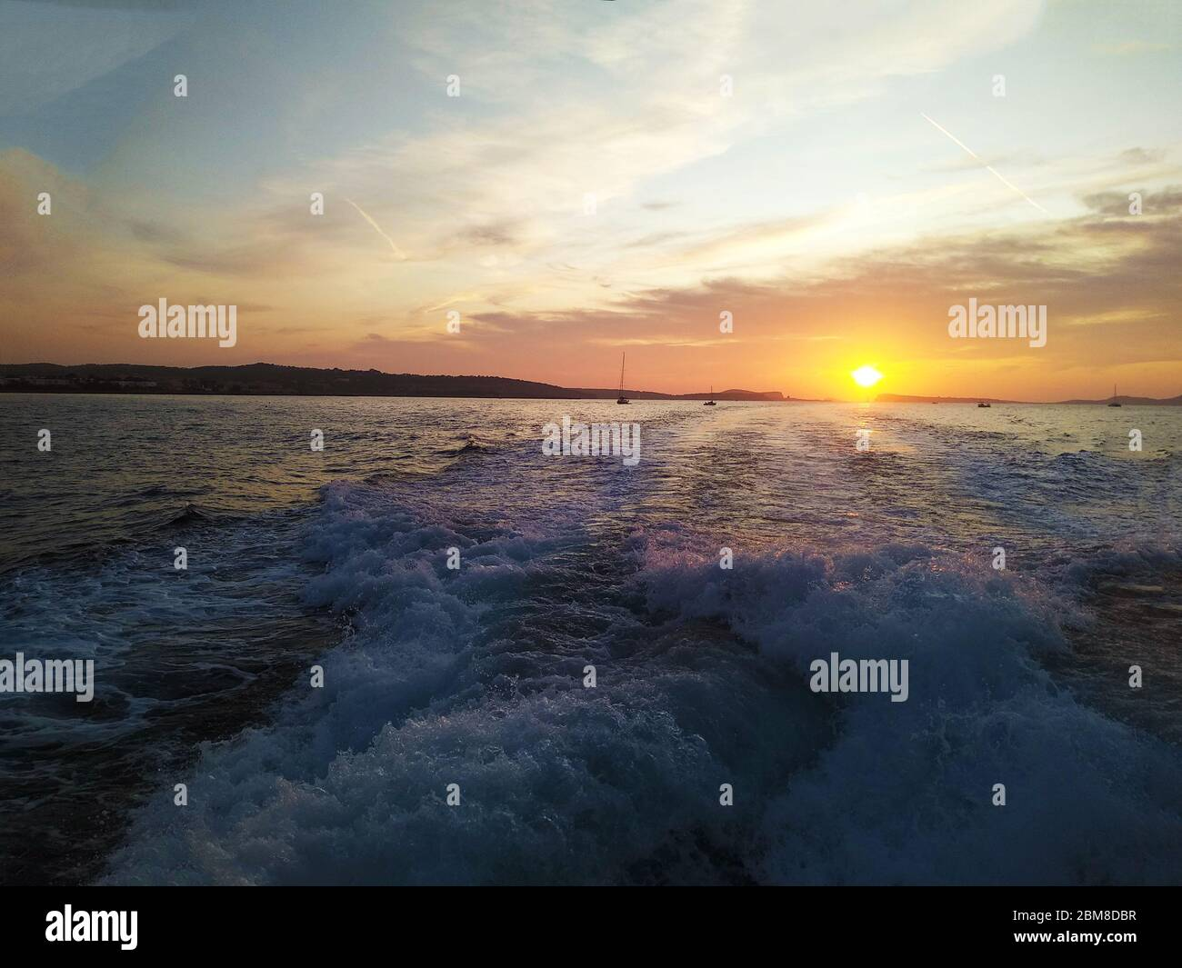 romantic sunset on the coast of the mediterranean sea in ibiza in spain Stock Photo