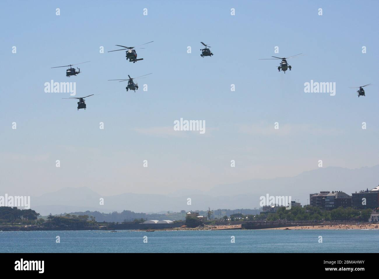 Series 101 of 165 Seven helicopter fly past at low level at the Armed Forces Day Santander Spain Stock Photo
