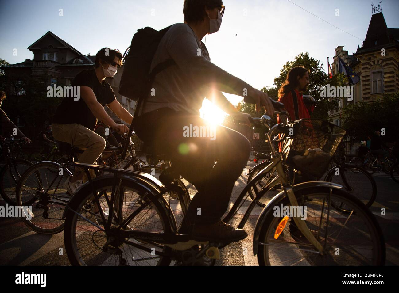 Ljubljana, Slovenia, May 8, 2020: People ride their bicycles  during an anti-government protest amid the coronavirus crisis. Following whistleblower's revelations of corruption in the government of Janez Janša and accusations of its undemocratic rule over five thousand people rode bicycles around government buildings in sign of protest. Stock Photo