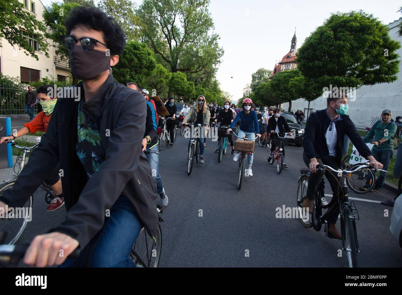 Ljubljana, Slovenia, May 8, 2020: Protesters wearing face masks as preventive measure ride their bicycles  during an anti-government protest amid the coronavirus crisis. Following whistleblower's revelations of corruption in the government of Janez Janša and accusations of its undemocratic rule over five thousand people rode bicycles around government buildings in sign of protest. Stock Photo
