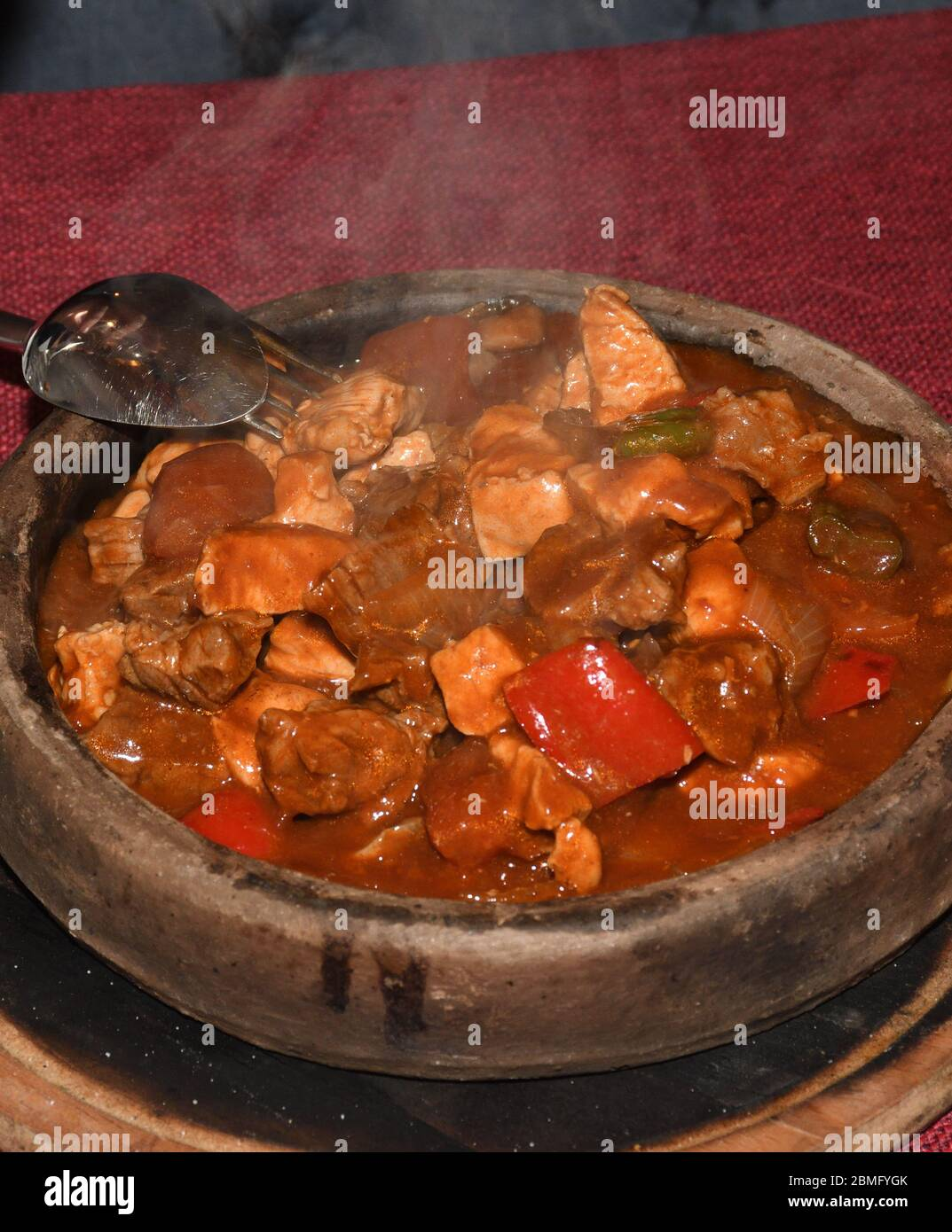 Home Cooked Lamb And Beef Or Pork Stew Served In A Traditional Restaurant In Wooden Bowl View Closeup Tomato Sauce Red Peppers Potato Carrots Stock Photo Alamy