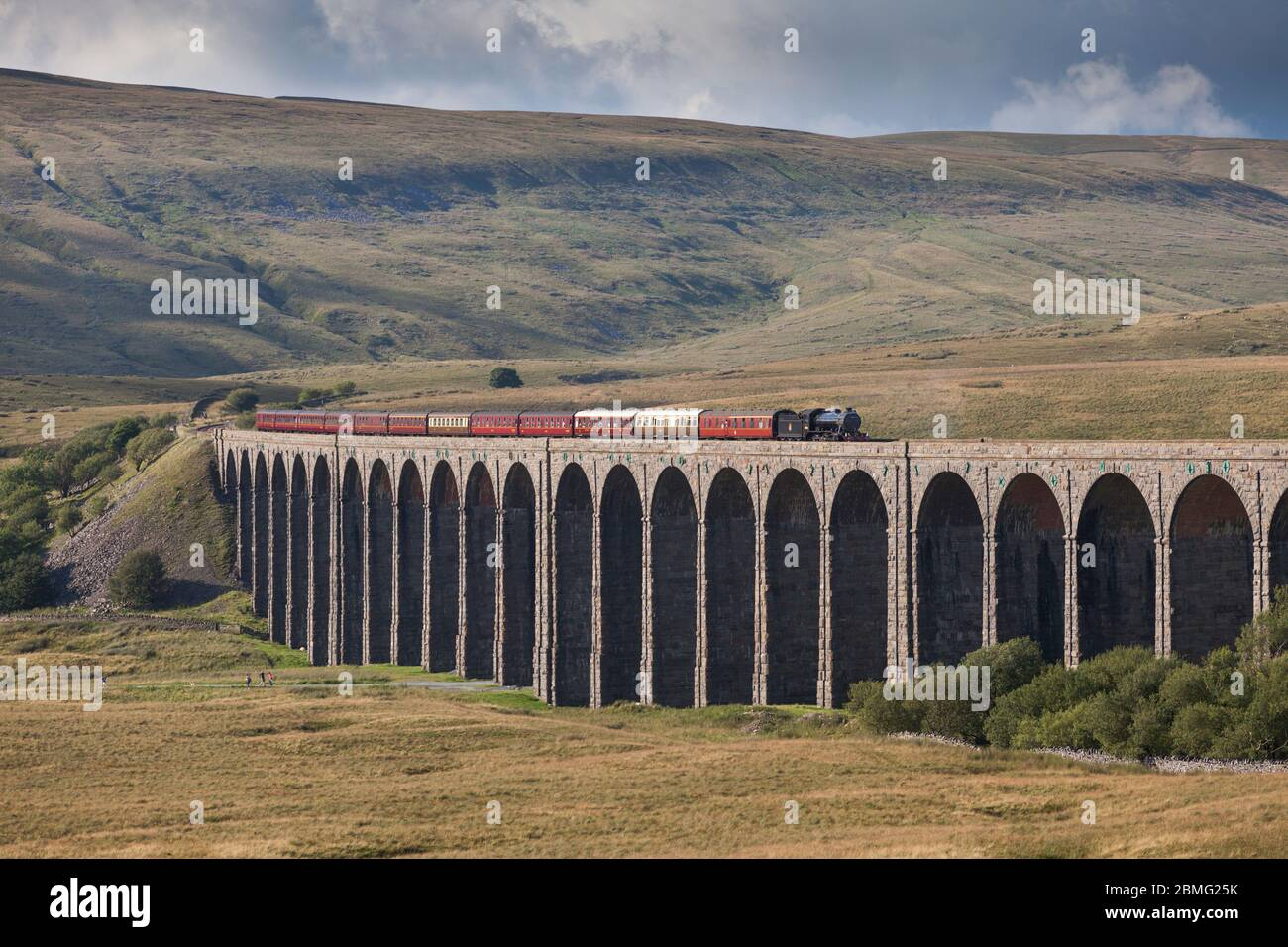 Steam locomotive 61994 The Great Marquess crossing Ribblehead viaduct on the settle to Carlisle line with the West coast railways fellsman train Stock Photo