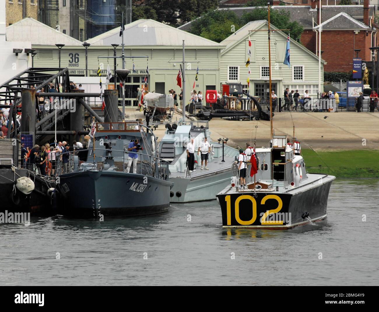 AJAXNETPHOTO. 25TH AUGUST, 2016. PORTSMOUTH, ENGLAND. - COASTAL FORCES 100TH ANNIVERSARY - RESTORED SECOND WORLD WAR COASTAL FORCES 'LITTLE SHIPS' FLOTILLA INCLUDING HARBOUR DEFENCE MOTOR LAUNCH MEDUSA, MGB 81, HSL 102 MOORING UP AT THE PNBPT BERTH OPPOSITE HMS WARRIOR. PHOTO:JONATHAN EASTLAND/AJAXREF:D162508 6194 Stock Photo