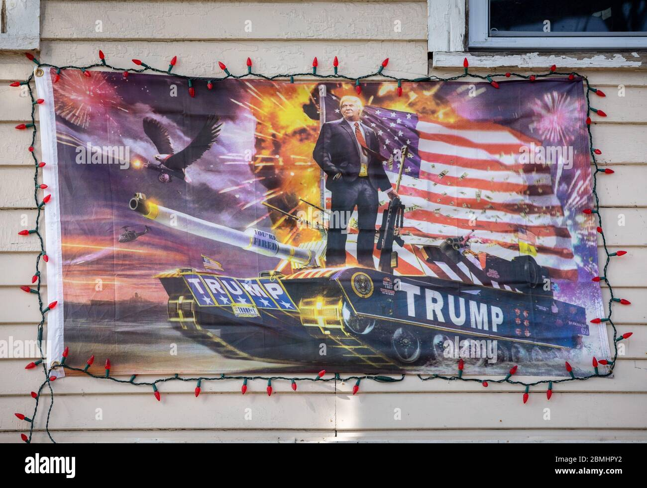 Herkimer, New York: Banner glorifiying militarism of Donald J. Trump, hanging on the front of a residence. Stock Photo