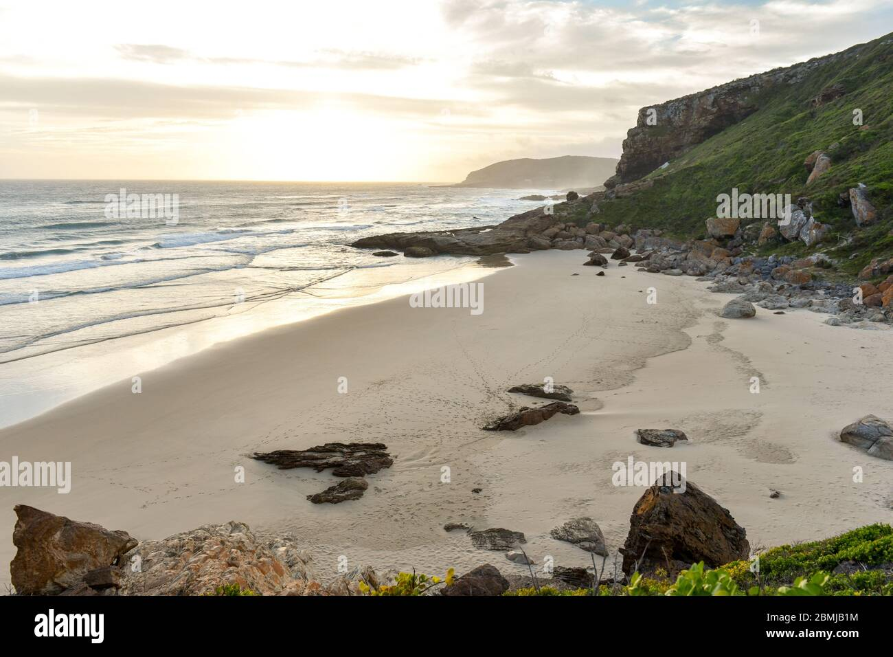 Sunset at the Robberg Beach and Robberg Nature Reserve near Plettenberg Bay, Garden Route, South Africa Stock Photo