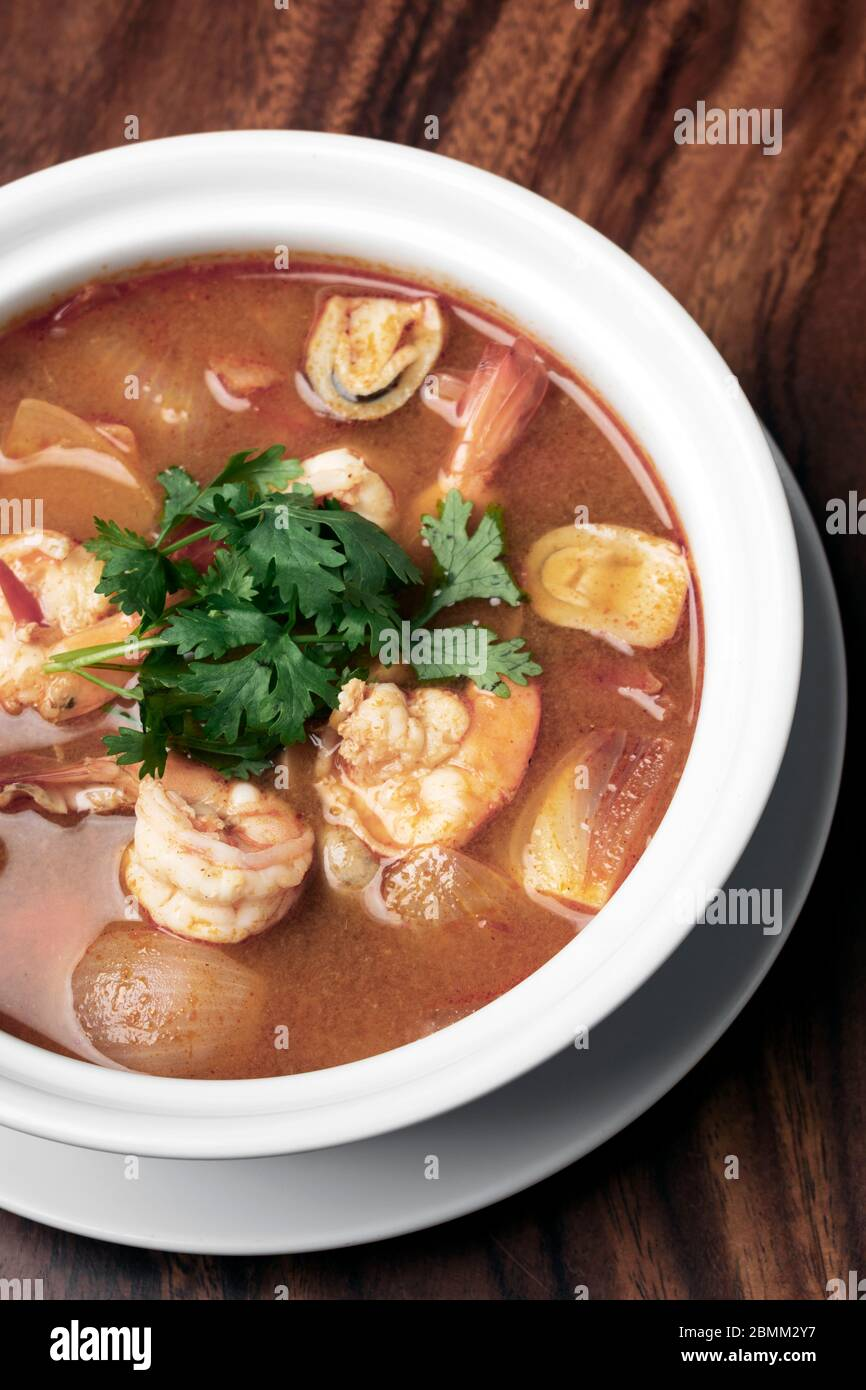 thai tom yum kung spicy and sour shrimp soup on wood table background in phuket thailand Stock Photo