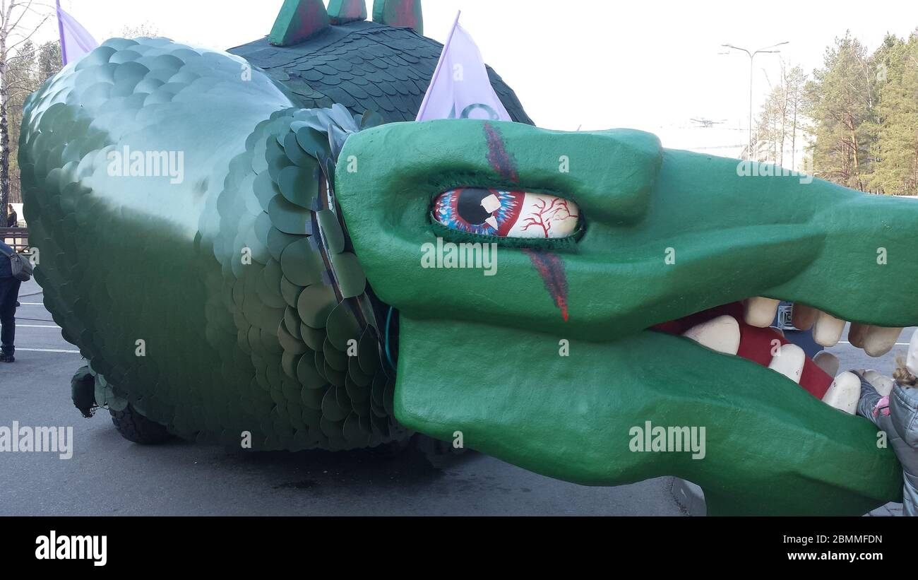 Huge green dragon sculpture with moving parts Stock Photo