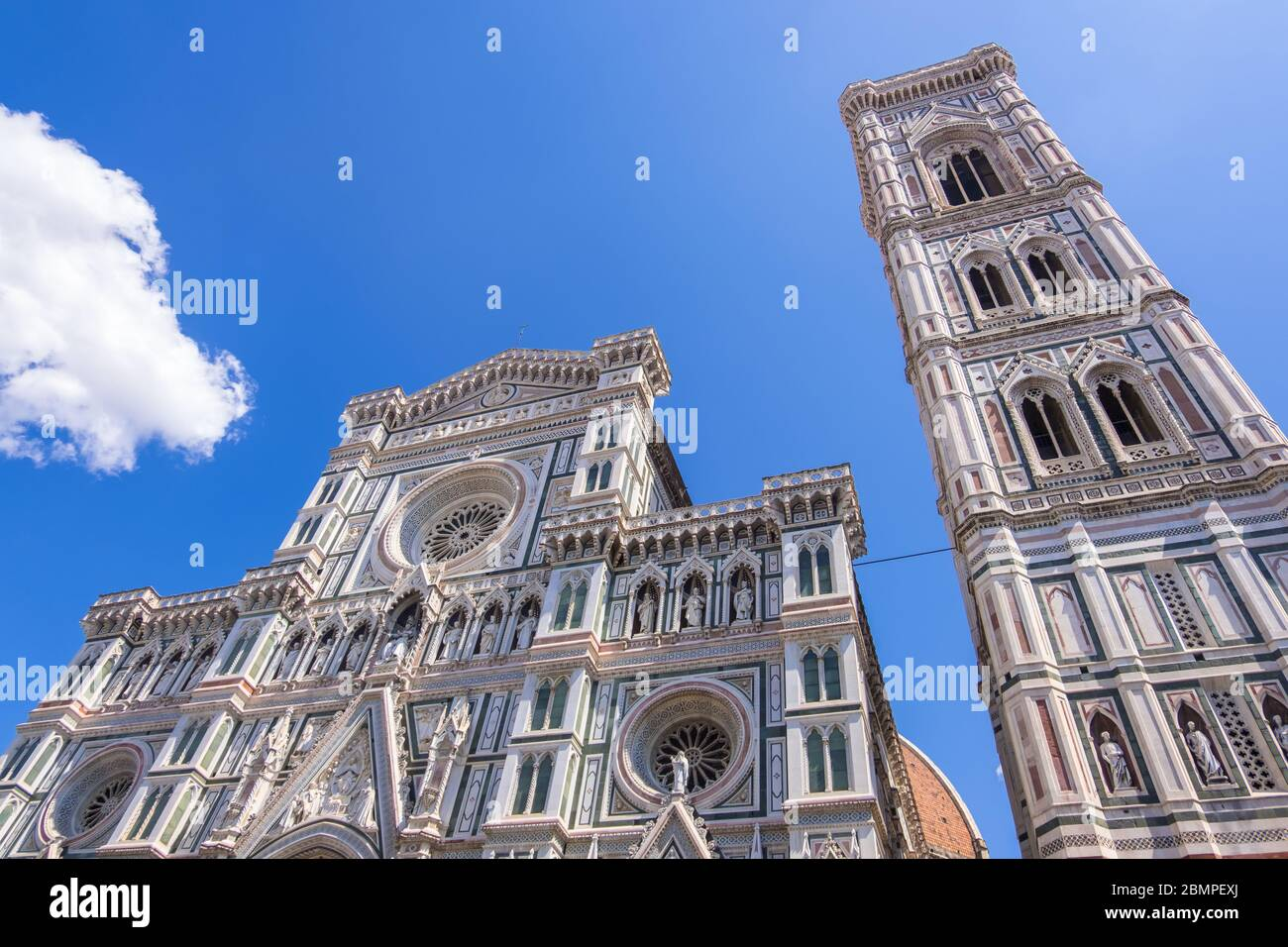 Florence, Italy - August 16, 2019: Cathedral Santa Maria Del Fiore and Giotto's Campanile on Piazza del Duomo in Florence Stock Photo