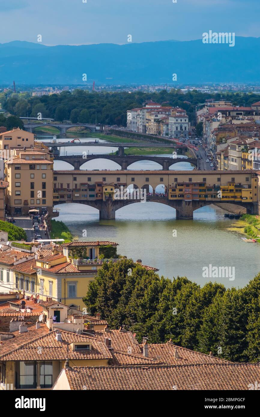 Florence, Italy - August 16, 2019: Florence cityscape and bridges on Arno River in Tuscany, Italy Stock Photo