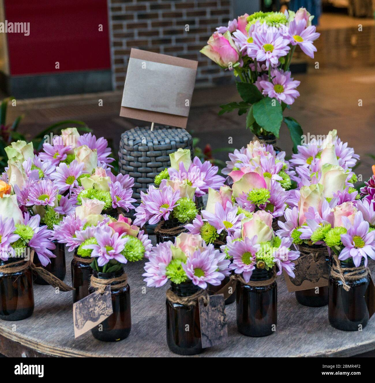 Small Purple And Green Flower Decorations In Vases Spring Wedding Flower Arrangements Background Stock Photo Alamy