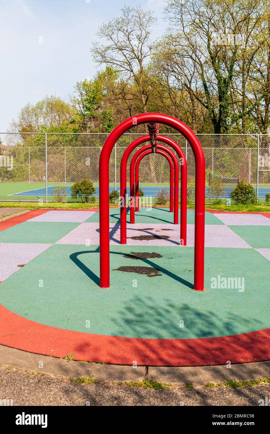 A swing set with the swings removed due to closure from the Covid 19 pandemic at the Swisshelm Park playground, Pittsburgh, Pennsylvania, USA Stock Photo