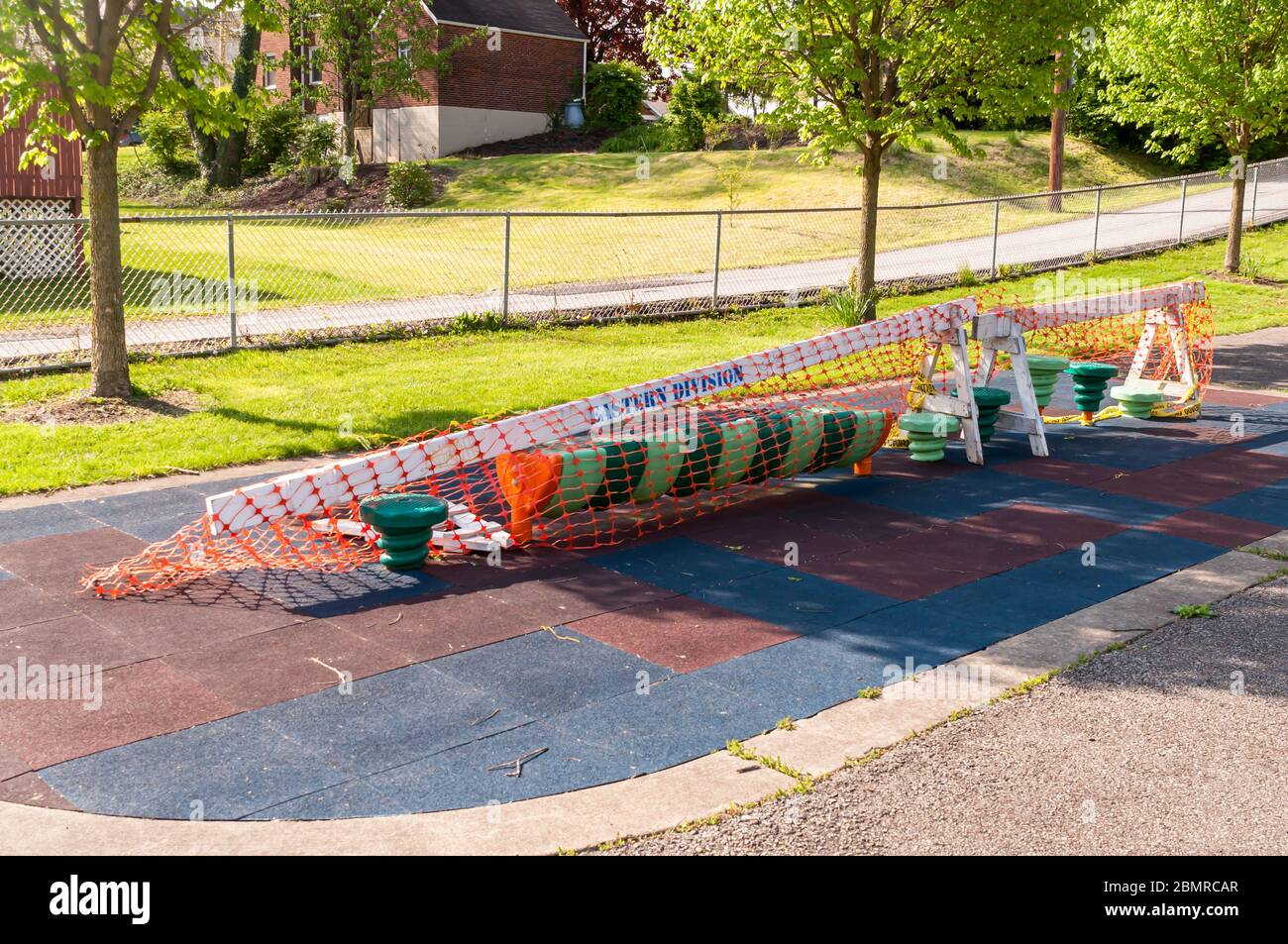 Playground equipment closed and roped off due to the Covid 19 pandemic at the Swisshelm Park playground, Pittsburgh, Pennsylvania, USA Stock Photo