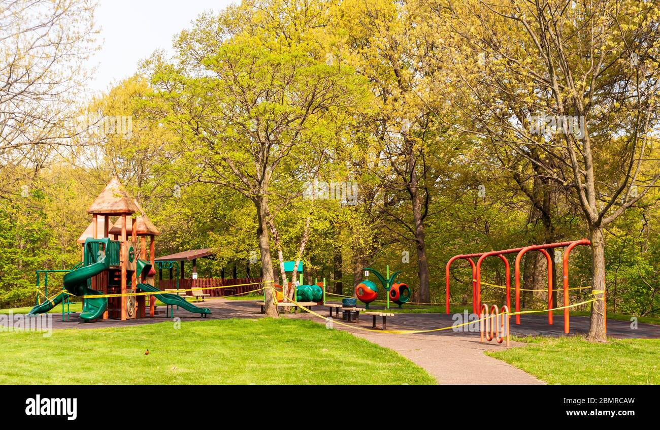 The Bartlett playground in Schenley Park, roped off and closed due to the Covid 19 pandemic, Pittsburgh, Pennsylvania, USA Stock Photo