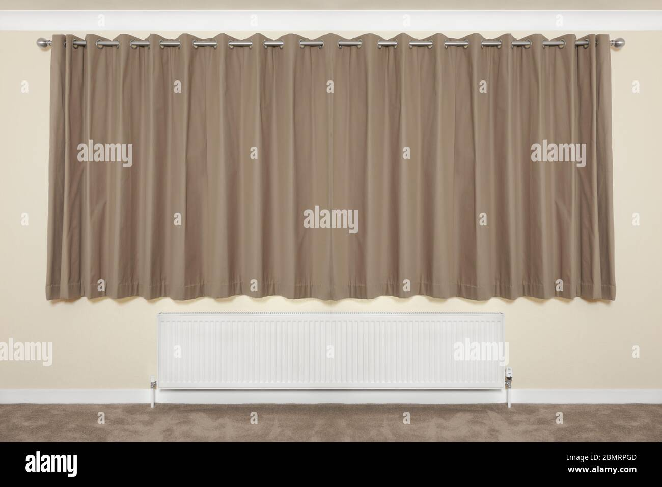 A Pair Of Curtains Hanging Above A Radiator Stock Photo Alamy