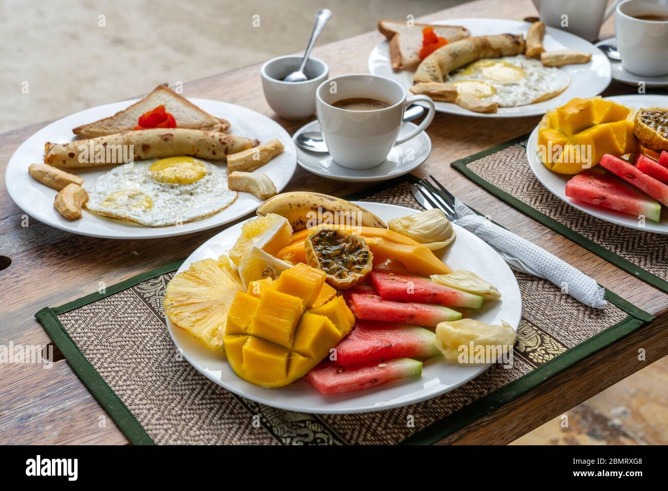 Tropical Breakfast Of Fruit Coffee And Scrambled Eggs And Banana Pancake For Two On The Beach Near Sea In Hotel Restaurant Island Zanzibar Tanzania Stock Photo Alamy