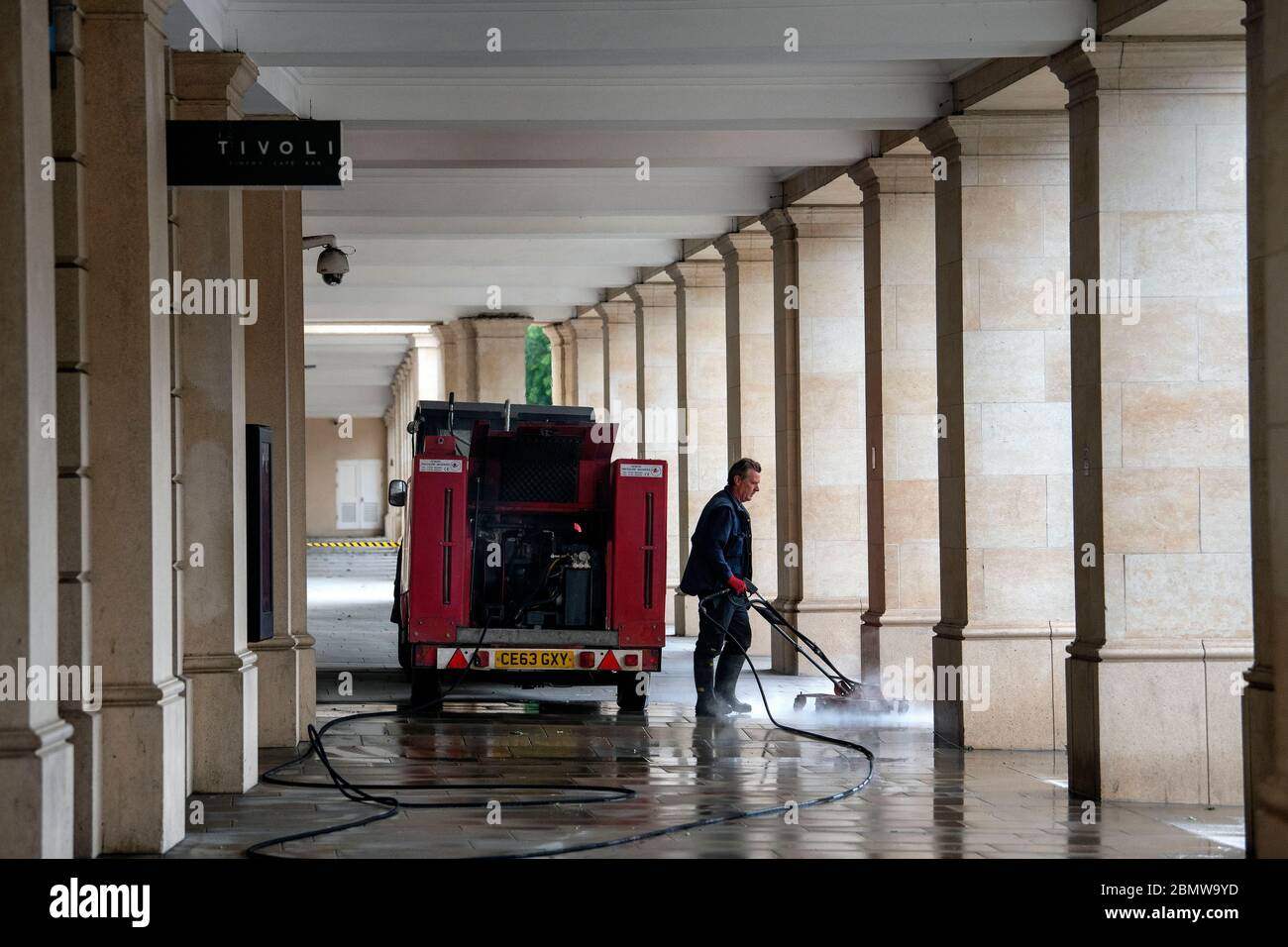 11.05.20. Coronavirus Pandemic, Bath, Somerset.  A worker cleans the streets in Bath, Somerset, as the UK government lockdown restrictions start to be Stock Photo