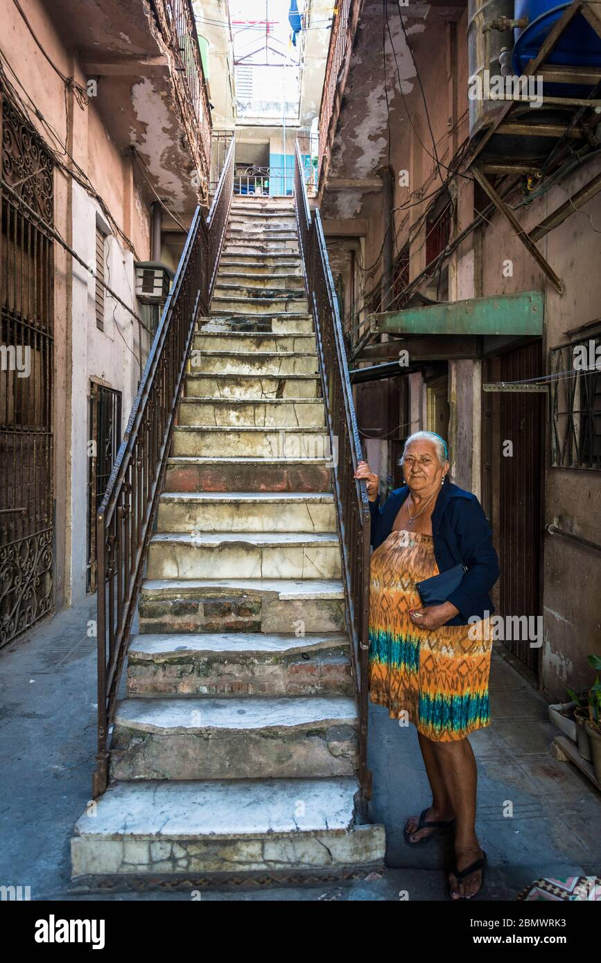 Older lady in the typical building where she has a little apartment, Old City Centre, Havana Vieja, Havana, Cuba Stock Photo
