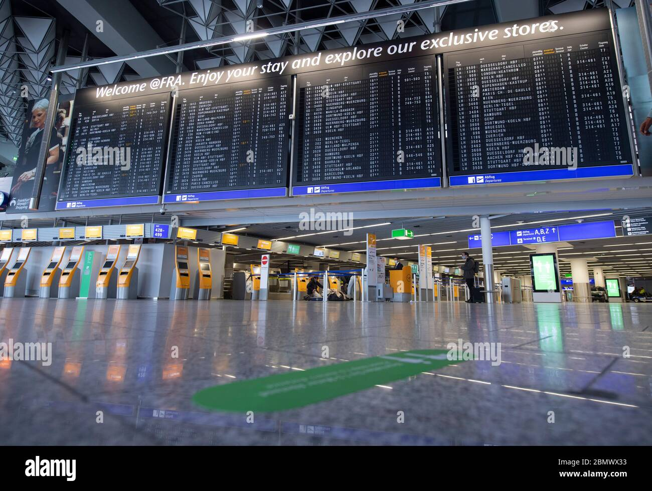 11 May 2020, Hessen, Frankfurt/Main: Terminal 1 of Frankfurt Airport is almost deserted at the Lufthansa check-in counters. Lufthansa has got into a massive financial imbalance as a result of the worldwide corona pandemic. Photo: Boris Roessler/dpa Stock Photo