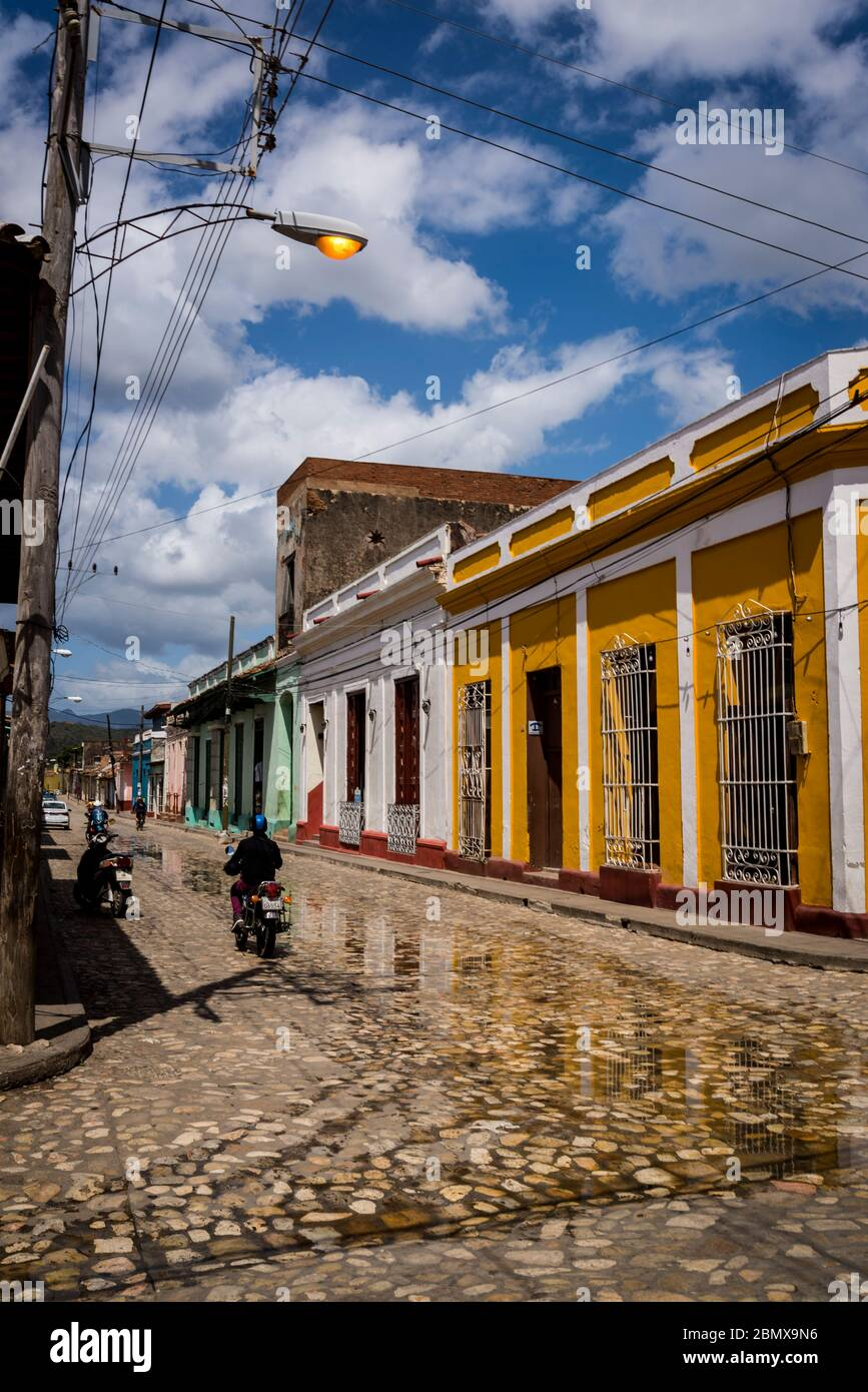 Typical cobblestoned street with colourful houses in the colonial era centre of the town, Trinidad, Cuba Stock Photo