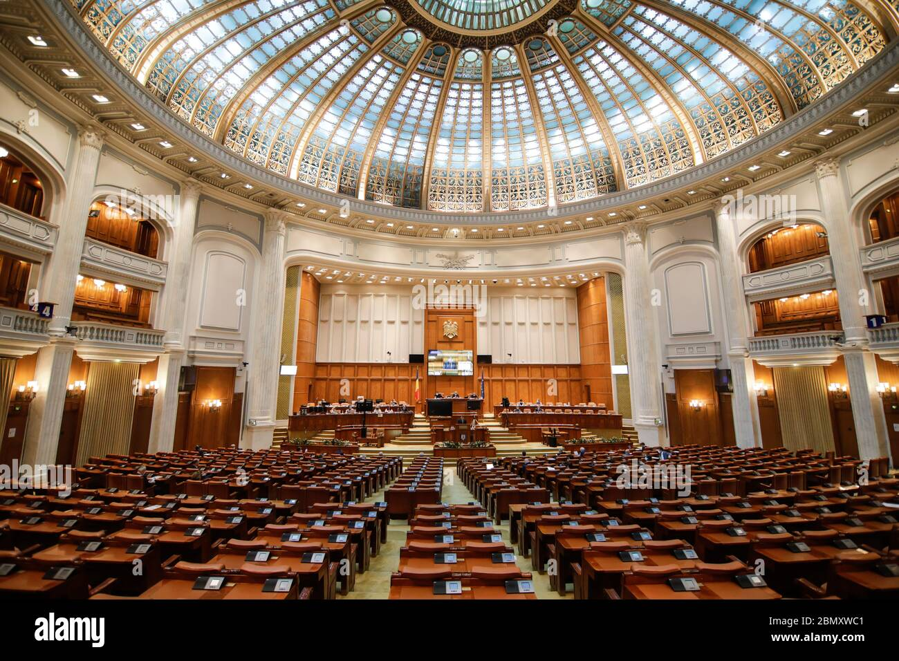 Bucharest, Romania - May 11, 2020: Romanian members of parliament attend a Parliament's session in the Chamber of Deputies hall of the Palace of Parli Stock Photo