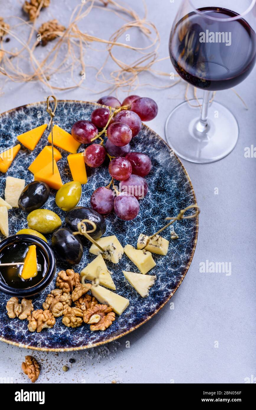 Cheese Plate With Grapes And Olives Snacks And Cheese Served With Red Wine Top View Copy Space Stock Photo Alamy