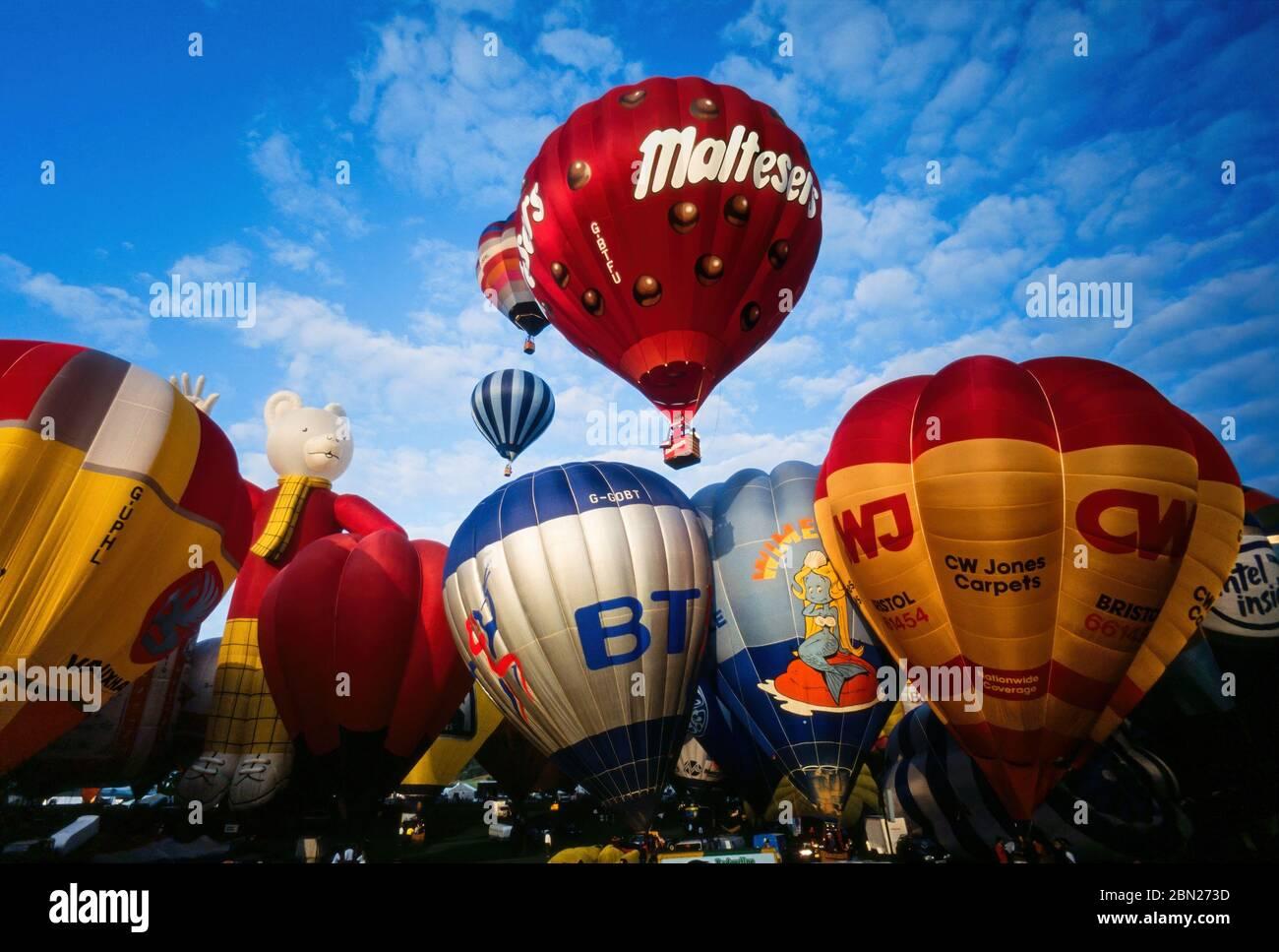 Early morning mass ascent of colourful hot air balloons at the Bristol International Balloon Fiesta, Ashton Court, Bristol, England, UK Stock Photo