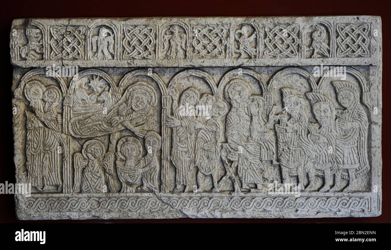 "Screen slabs from the Church of St. Nediljica in Zadar, 11th century (copy). Croatia. Left : Shepherds watch the ""First Bath"" (under the Star of Bethlehem). Right: Mary, seated on a folding chair, having Jesus on her knees, welcomes the Magi (wearing phrygian caps). Museum of Croatian Archaeological Monuments. Split. Croatia. Stock Photo"
